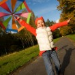 Stock Photo: Beautiful little girl with umbrella