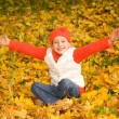 Beautiful little girl with autumn leaves — Stock Photo #1421324