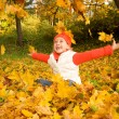 Beautiful little girl with autumn leaves — Foto de Stock   #1421338