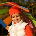 Beautiful little girl with umbrella — Stock Photo #1421355