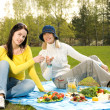 Two beautiful girls at picnic - Stock Photo