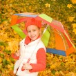 Beautiful little girl with umbrella — Stock Photo #1421400