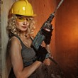 Beautiful blond woman with heavy perforator in h — Stock Photo #1421576