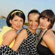 Three beautiful woman outdoors - Stock Photo