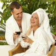Happy couple with a glasses of wine — Stock Photo
