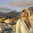 Attractive young woman near the yachts — Stock Photo #1421917