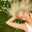 Young woman relaxing on a meadow — Stock Photo #1421926