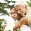 Foto Stock: Happy young couple outdoors