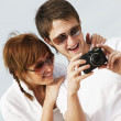 Happy couple with a digital camera — Stock Photo
