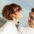 Happy young couple listening to music — Stock Photo