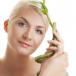 Woman with a bamboo plant — Stock Photo