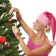 Santa girl decorating the christmas tree — Foto Stock