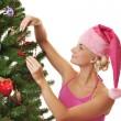 Santa girl decorating the christmas tree — Stock Photo