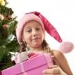 Royalty-Free Stock Photo: Little santa girl holding a gift box