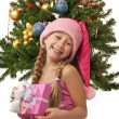 Happy Santa girl near the christmas tree — Stock Photo #1422446
