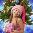 Happy Santa girl near the christmas tree - Stock Photo