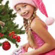 Little santa girl holding a gift box — Stock Photo #1422468