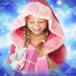 Little Christmas girl open her present — Stock Photo #1422470