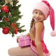 Happy Santa girl near the christmas tree — Stockfoto