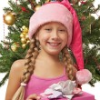 Stock Photo: Santa girl near the christmas tree