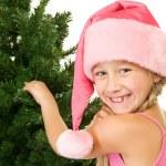 Little santa girl near christmas tree — Stock Photo