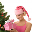 Santa girl with christmas present — Foto de Stock