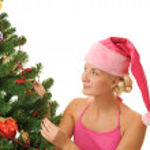 Santa girl decorating christmas tree — Stock Photo
