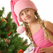 Little santa girl holding a gift box — Stock Photo