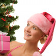 Santa girl with christmas present — Stock Photo