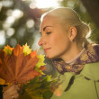 Woman with golden autumn leaves — Stock Photo #1422676