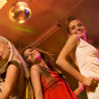 Girls dancing in the night club — Stock Photo