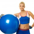 Fitness trainer with a ball — Stock Photo #1422838