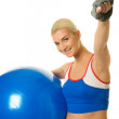 Beautiful fitness trainer with a ball — Stock Photo #1422842