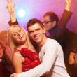 Happy couple in the night club — Stock Photo