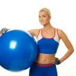 Fitness trainer with a ball — Stock Photo #1422974