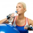 Woman with a bottle of water — Stock Photo #1422986
