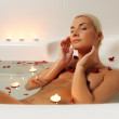 Young woman relaxing in bathroom — Stock Photo #1423022