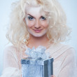 Snow queen with a christmas box — Stock Photo #1423039