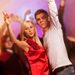 Happy couple in the night club — Stock Photo #1423119