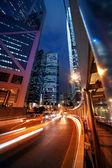 Fast moving cars at night — Fotografia Stock