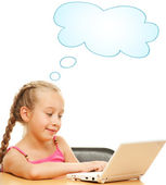 Little schoolgirl with a laptop — Stock Photo