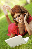 Young woman with laptop outdoors — Stock Photo