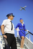 Picture of a cabin crew couple — Stok fotoğraf