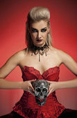 Witch with a scull — Stockfoto