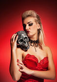 Witch with a scull — Stock Photo