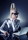 Cyber woman working on her laptop — Stock Photo