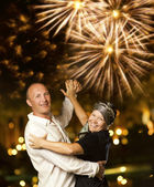 Middle-aged couple dancing waltz at night — Stock Photo