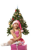 Santa girl near the christmas tree — Stock Photo