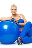 Fitness trainer with a ball — Stock Photo