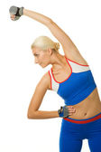 Fitness trainer doing exercise — Stock Photo